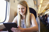 Blond girl using digital tablet — Foto de Stock
