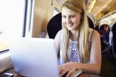 Blond girl using laptop — Stock Photo