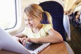 Little girl using laptop — Foto de Stock
