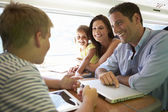 Happy family traveling by train — Stock Photo