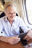 Old man using digital tablet — Stock Photo