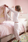 Young Girl Making Her Bed — Stock Photo