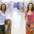 Two women meeting in supermarket — Stock Photo #4757734