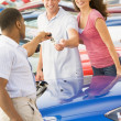 Young couple collecting new car — Stock Photo #4757754