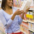 Young woman grocery shopping — Stock Photo #4757853