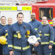 Portrait of a group of firefighters by a fire engine — Stock Photo #4758252