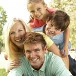 Family Group Having Fun In Park — Stock Photo #4815790