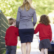 Mother Walking To School With Children — Stock Photo #48295469