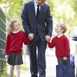 Father Walking To School With Children — Stock Photo #48295533