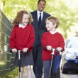 Children Riding Scooters — Stock Photo #48295583