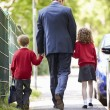 Father Walking To School With Children — Stock Photo #48295595