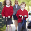Children Riding Scooters — Stock Photo #48295635