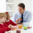 Father And Children Having Breakfast — Stock Photo #48296017