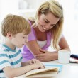 Mother Helping Son With Homework — Stock Photo #48296173