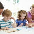 Parents Helping Children With Homework — Stock Photo #48296197