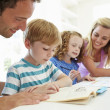 Parents Helping Children With Homework — Stock Photo #48296203