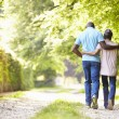 Couple Walking In Countryside — Stock Photo #48297793