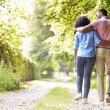 Couple Walking In Countryside — Stock Photo #48298119