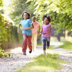 Children Running In Countryside — Stock Photo #48298189
