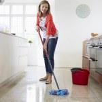 Woman Mopping Kitchen Floor — Stock Photo #48298829