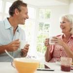 Middle Aged Couple Enjoying Breakfast — Stock Photo #48299061