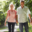Couple Walking Along Countryside Path — Stock Photo #48299603