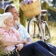 Woman Relaxing On Country Cycle Ride — Stock Photo #48299687
