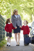 Mother Walking To School With Children — Photo
