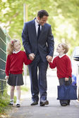 Father Walking To School With Children — Stockfoto