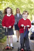 Children Riding Scooters — Stock Photo