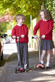 Boy And Girl Riding Scooter — Stock Photo