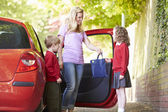 Mother Driving To School With Children — Stock Photo