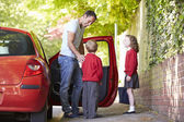 Father Driving To School With Children — Stock Photo