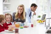 Family Having Breakfast In Kitchen — Stock Photo