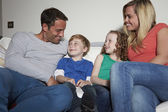 Family Sitting Watching TV Together — Stock Photo