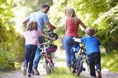 Family Pushing Bikes — Stock Photo