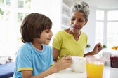 Grandmother And Grandson Having Breakfast — Stock Photo