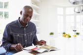 Man Reading Magazine At Home — Stock Photo