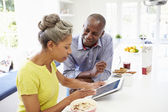 African American Couple Using Digital Tablet — Stock Photo