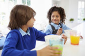 Two Children Having Breakfast — Stock Photo