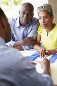 Couple Meeting With Financial Advisor — Foto Stock