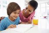 Mother Helping Son With Homework — Stock Photo
