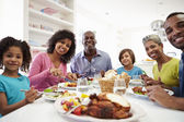 Family Eating Meal At Home — Foto Stock