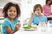 Family Eating Meal At Home Together — Stock Photo