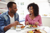 Couple Eating Meal At Home — Stock Photo