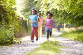 Children Running In Countryside — Stock Photo