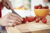 Woman Preparing Fruit Salad — Stock Photo