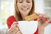 Woman Dipping Biscuit — Stock Photo