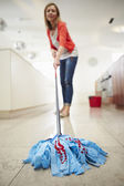 Woman Mopping Kitchen Floor — 图库照片