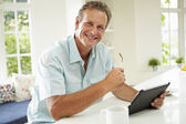 Man Using Digital Tablet Over Breakfast — Stock Photo